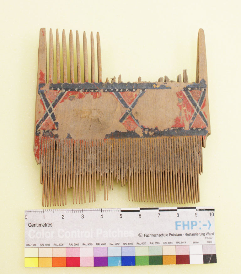 Wooden comb, painted red and black