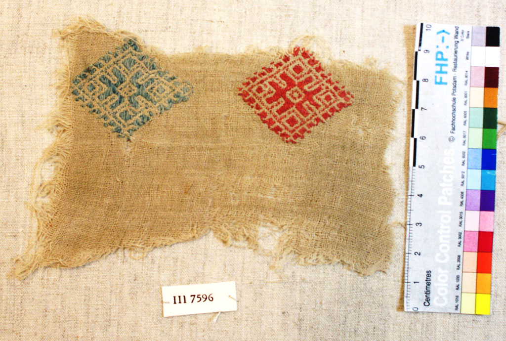 Cotton fragment with blue and red embroidery