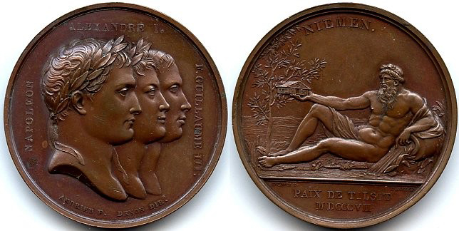 Left: bronze disc with three heads facing right; Right: bronze disc with man reclining, holding a tiny house in his extended right hand