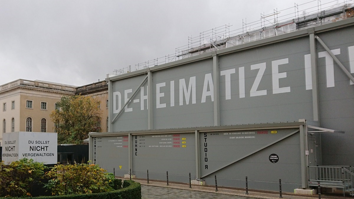 Theater container with DEHEIMATIZE IT! painted on the side